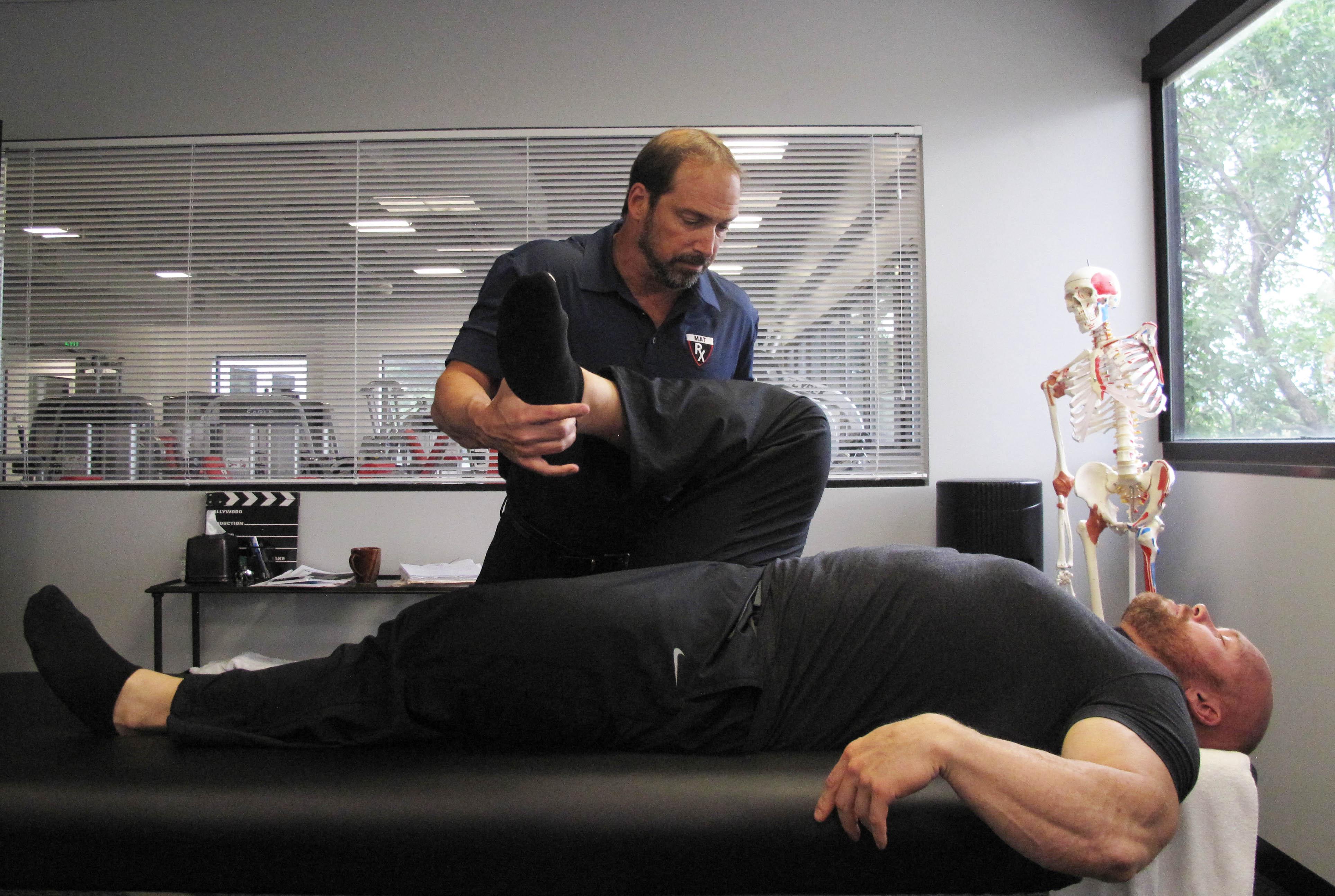 IFBB Pro Ben Pakulski and Greg Roskopf working on knee internal rotation